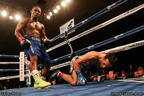Dashon Johnson - now fighting in Nanaimo May 2 - stands over former world champion Sergio Mora.